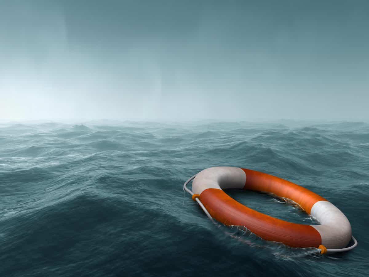 sea kayaking - lost at sea - life buoy floats is grey and moody water