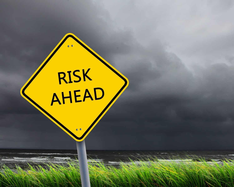 risks of kayaking yellow sign warning of danger
