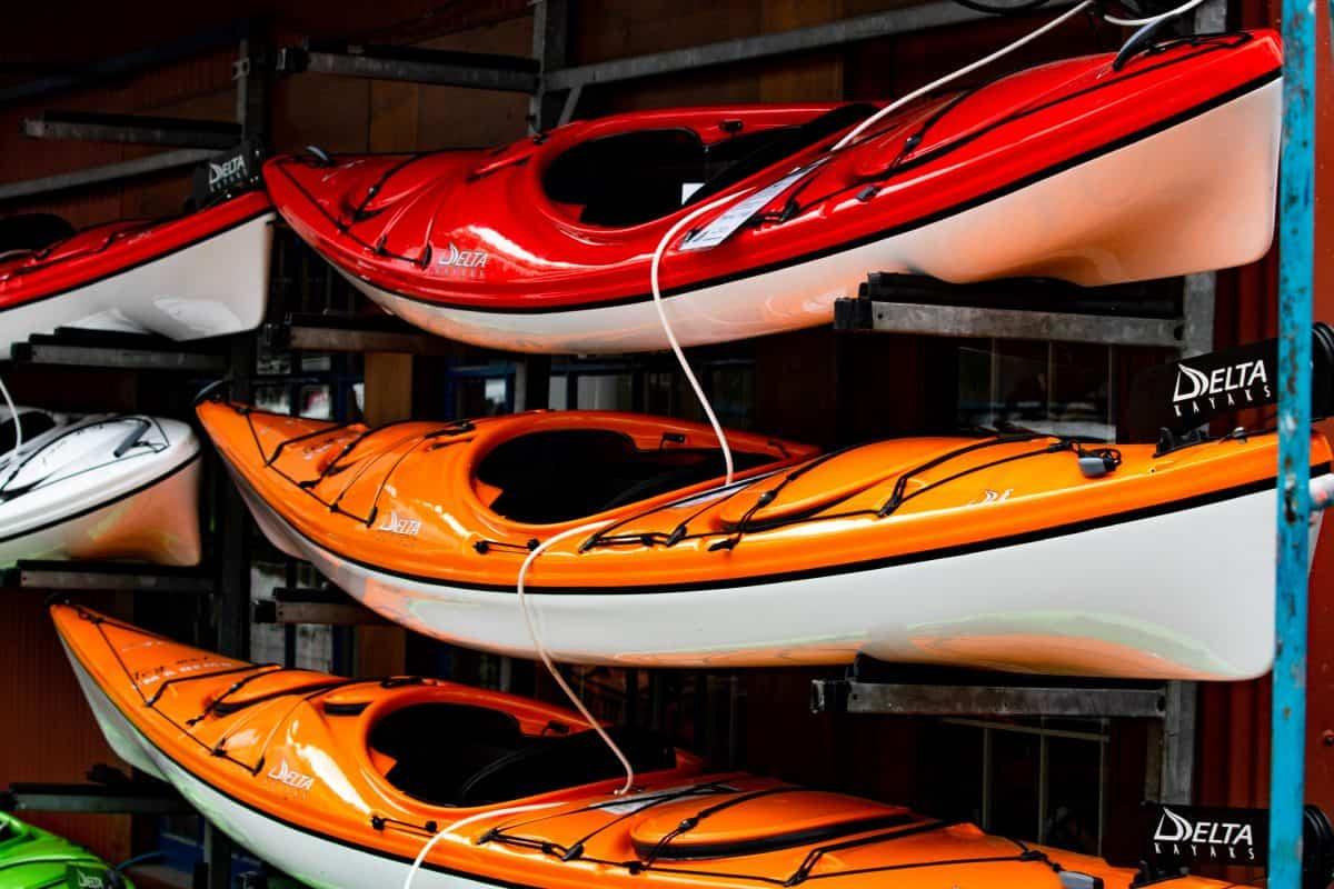 small lightweight recreational kayaks stored on a kayak rack