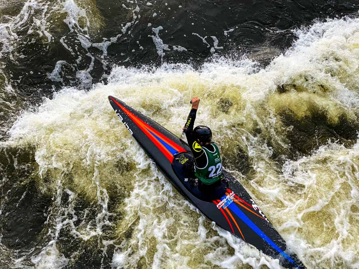 Person in black river runner tackling the rapids