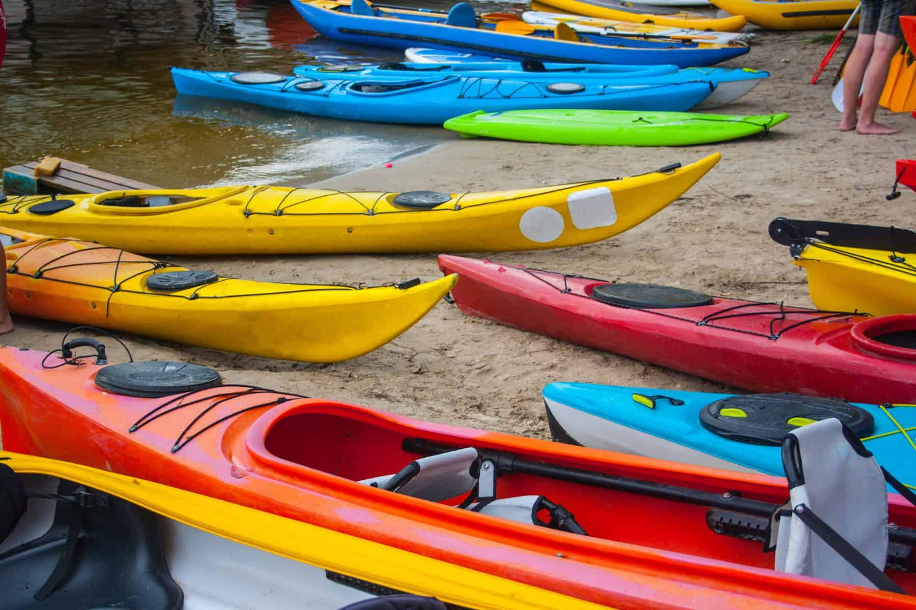 Different type of kayaks on beach