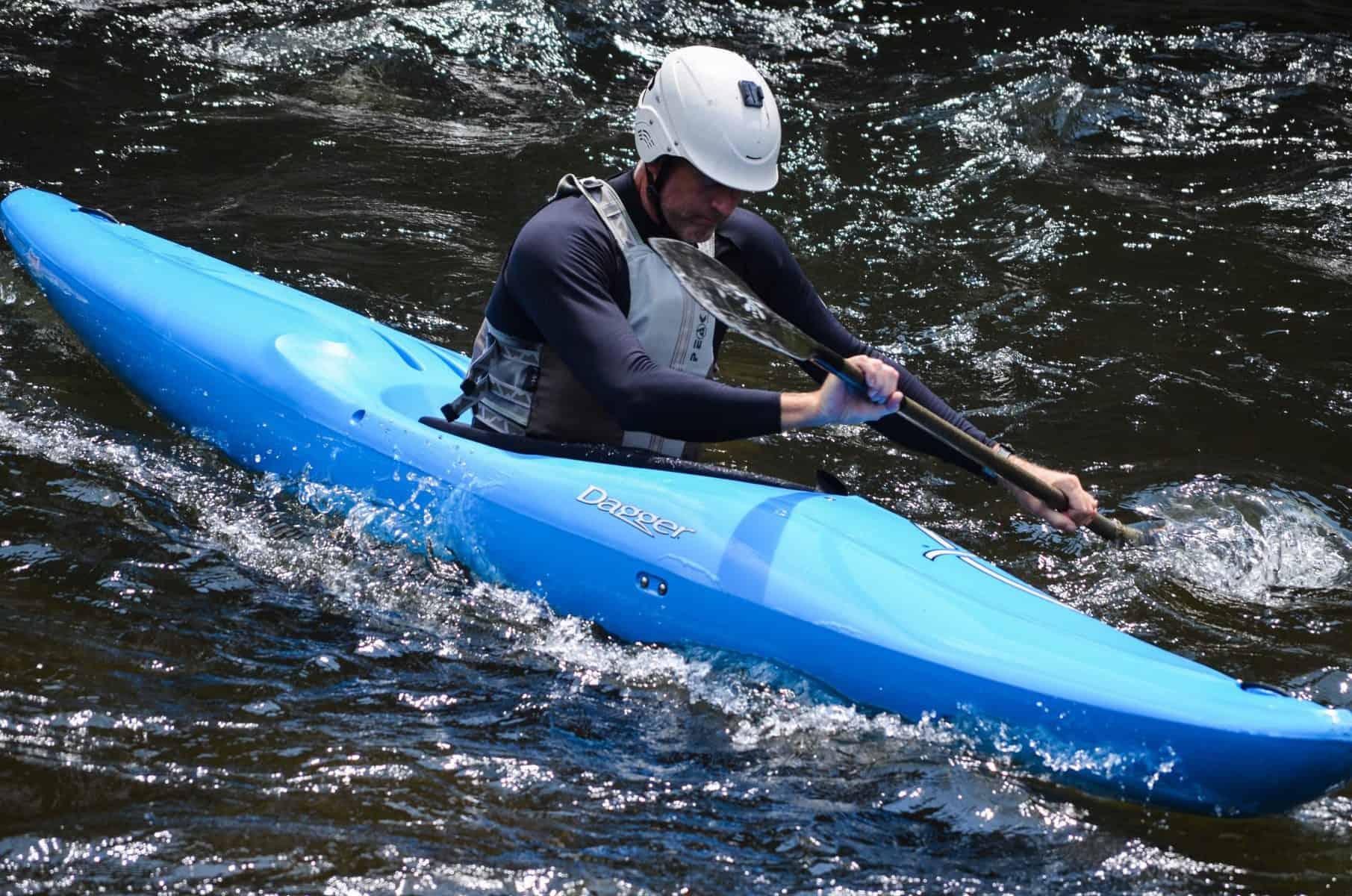 Man in blue Creeker whitewater kayak