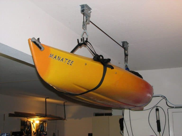 Kayak suspended in pulley hoist system