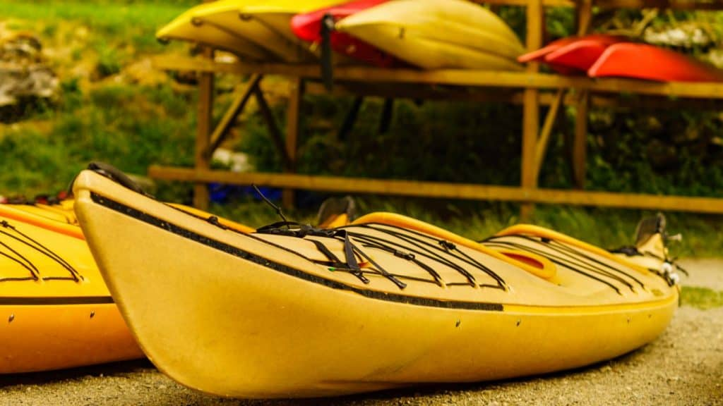 Yellow kayak ready for inspection