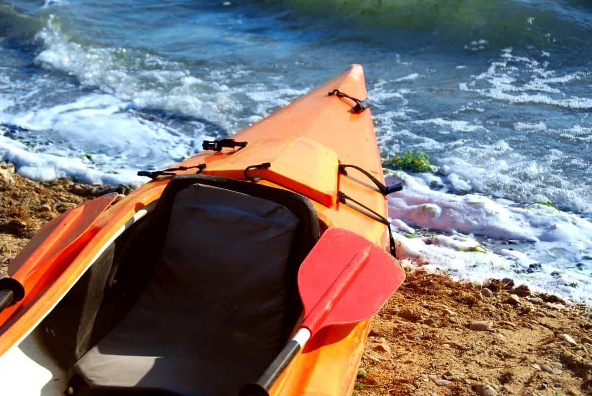 Orange kayak read for test paddle