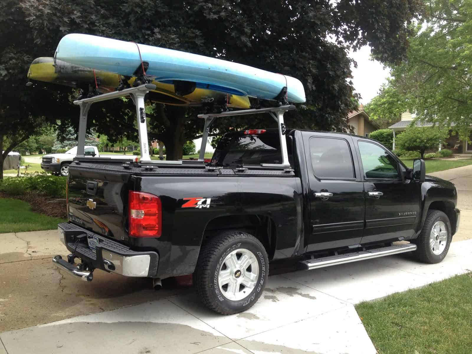 Kayaks being transported on black truck