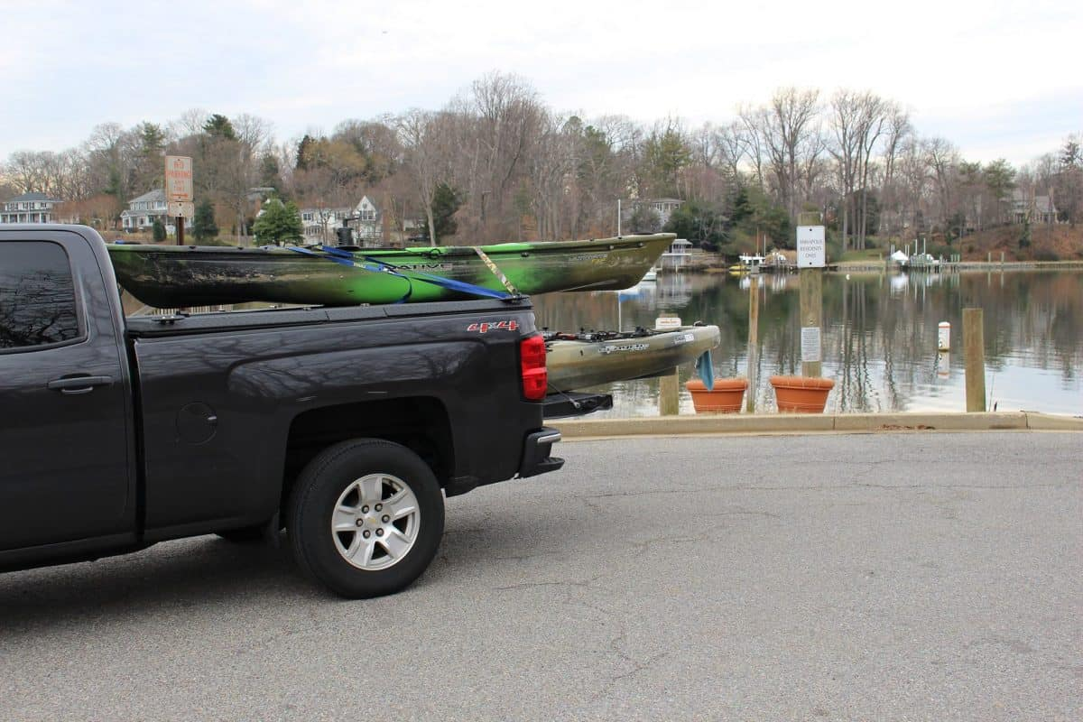 kayaking being transported in the bed of a truck