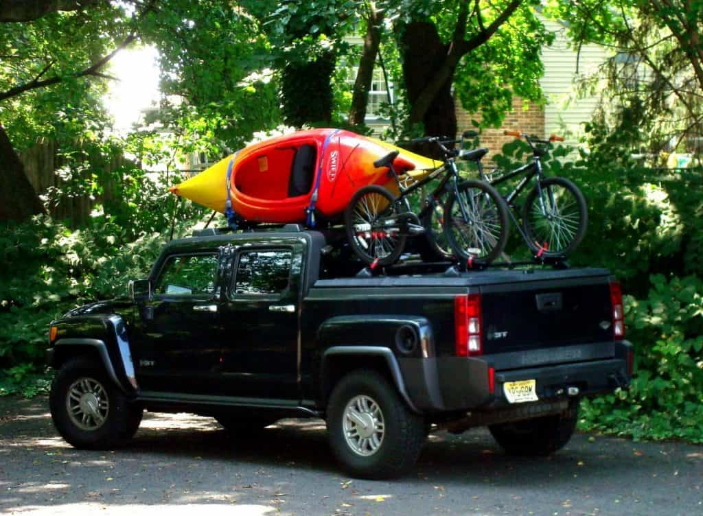 Kayaks and bikes being transported on black truck