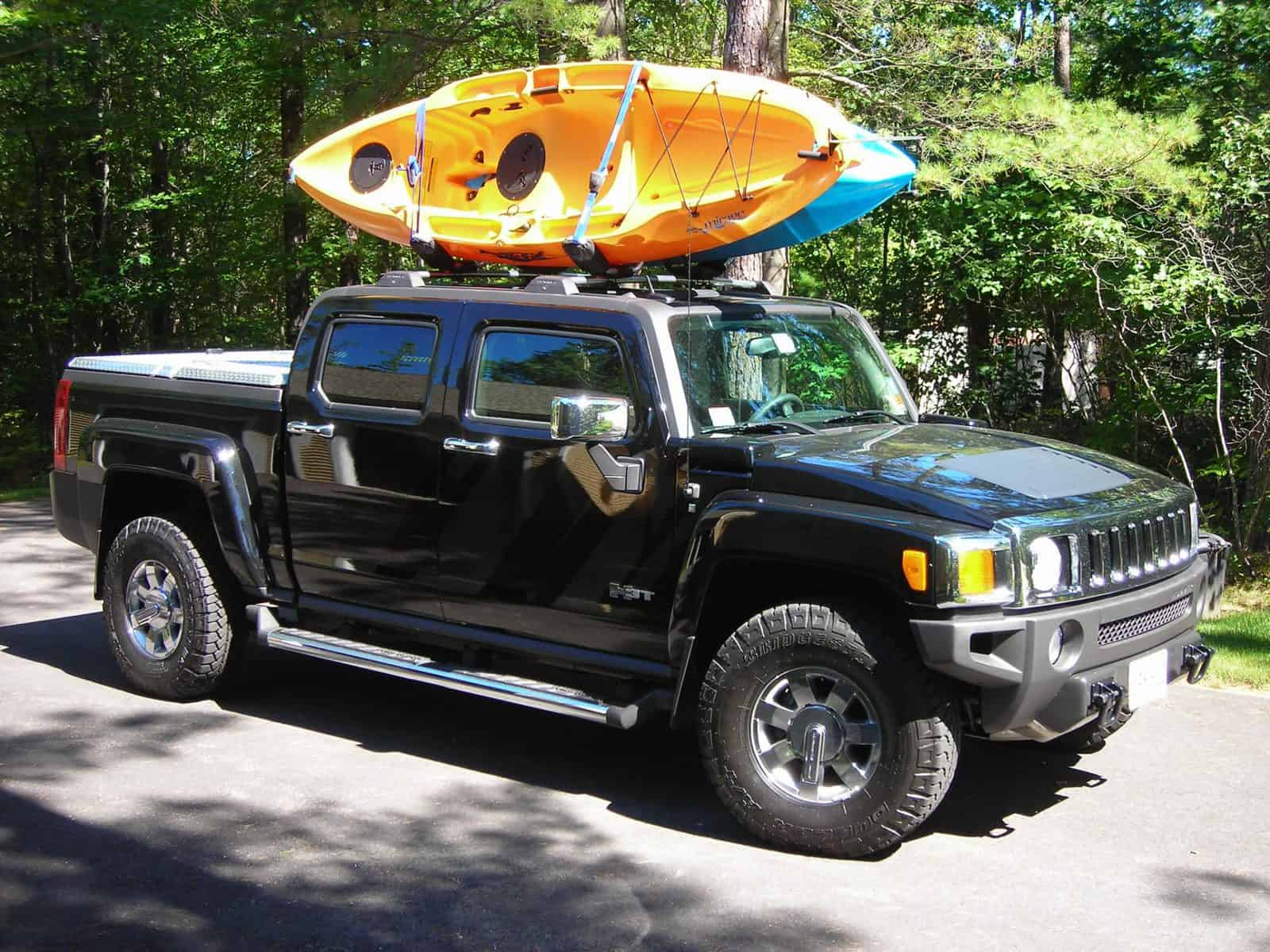 Two kayaks being transported on pick up truck rack