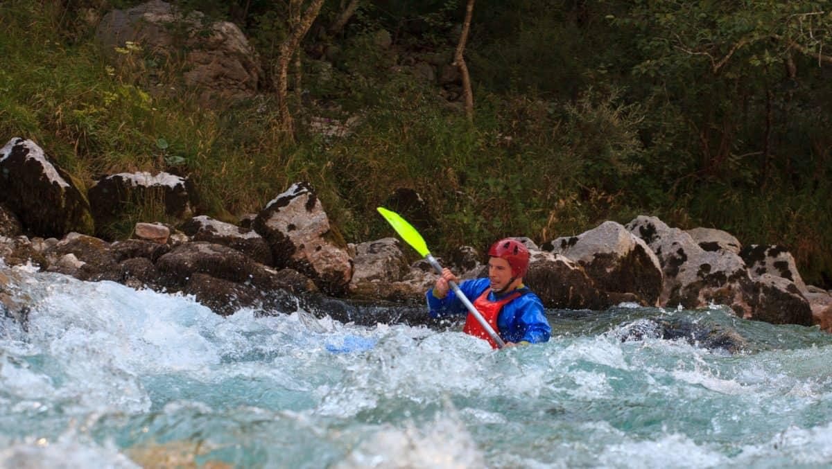Kayaker suck in river strainer