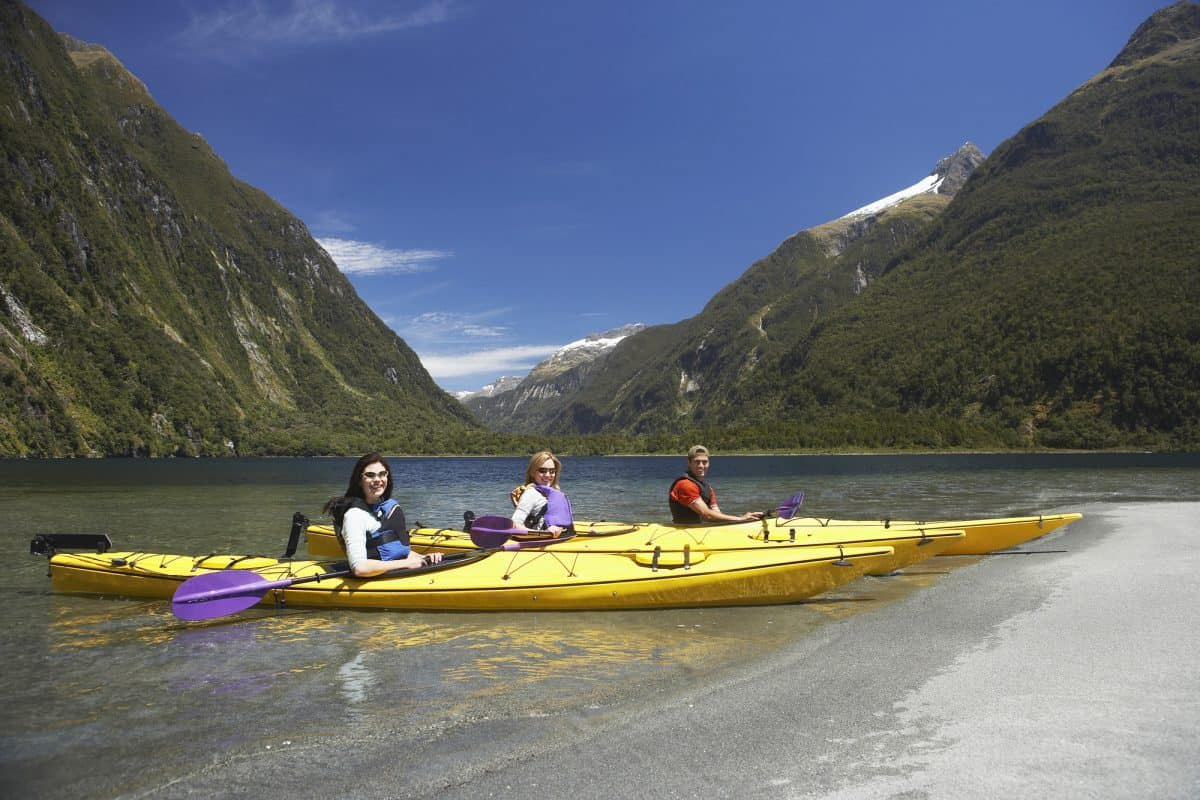Three people each in a long touring kayak
