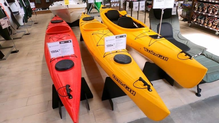 red and two yellow kayaks for sale