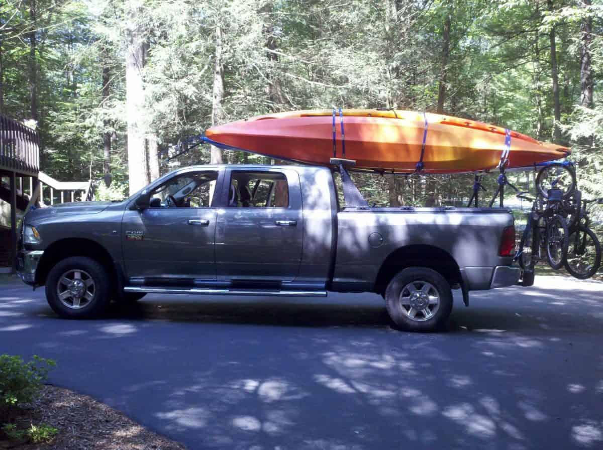 Silver Truck with Orange Kayak on rack