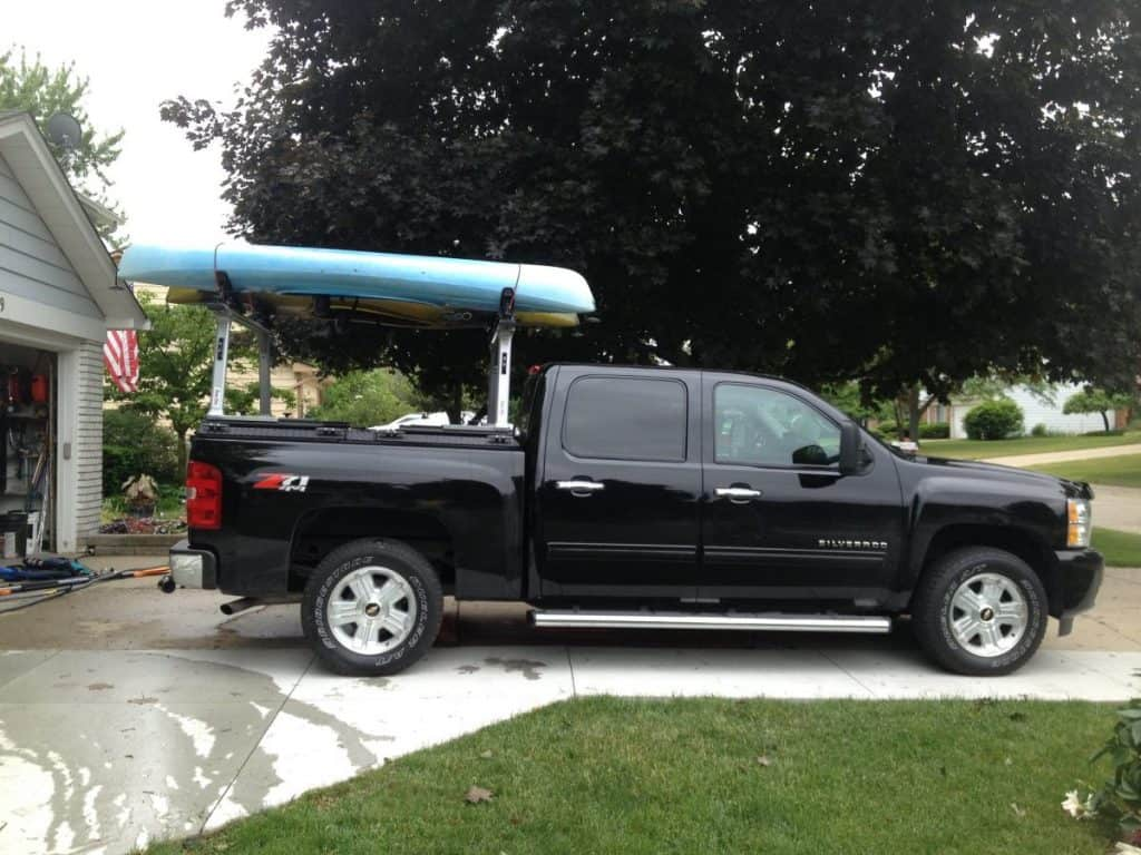 Blue kayak on truck bed rack
