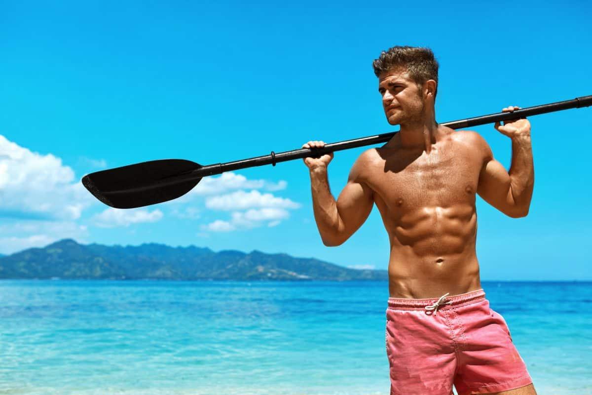 Man With Canoe Kayak Paddle On Beach