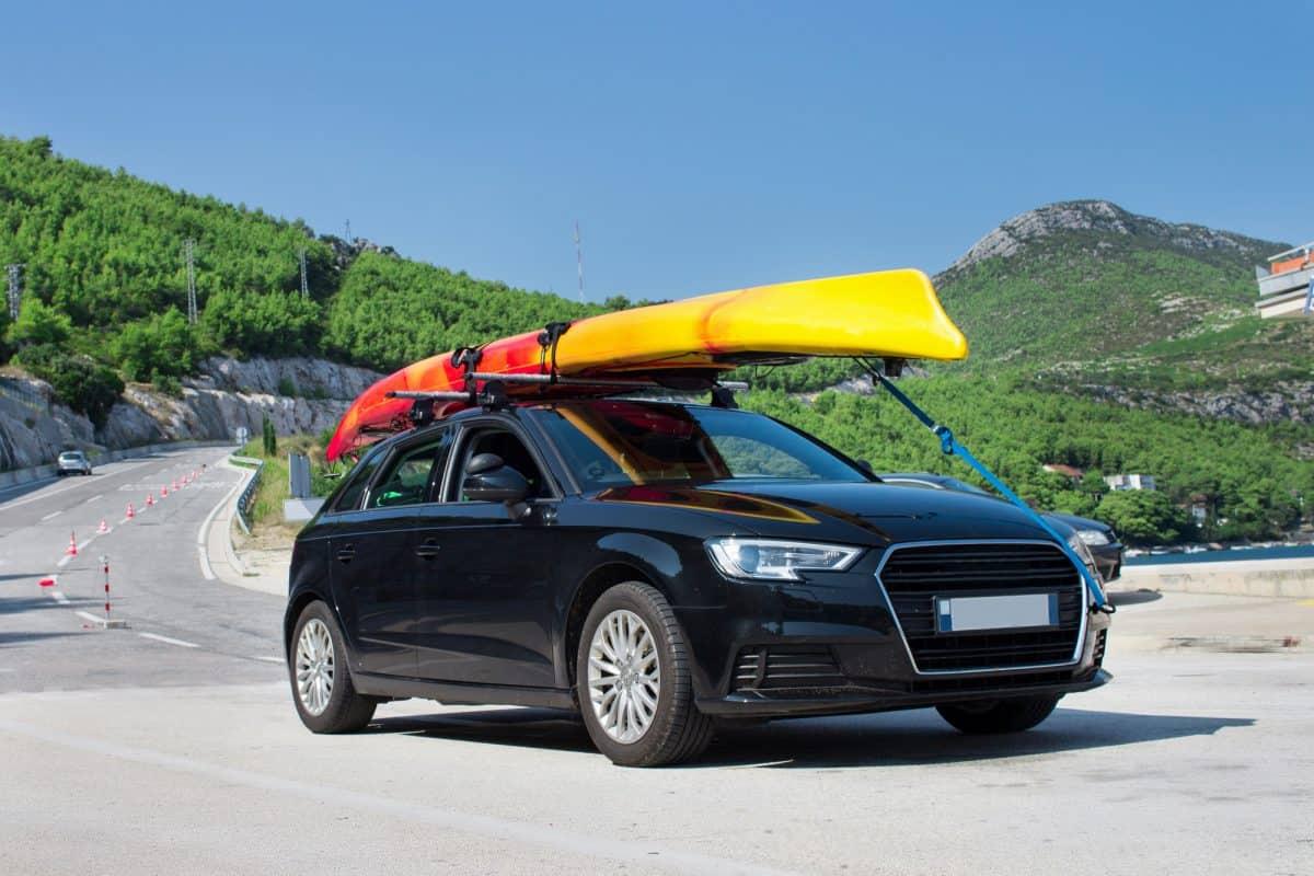 transporting yellow kayak on its ro