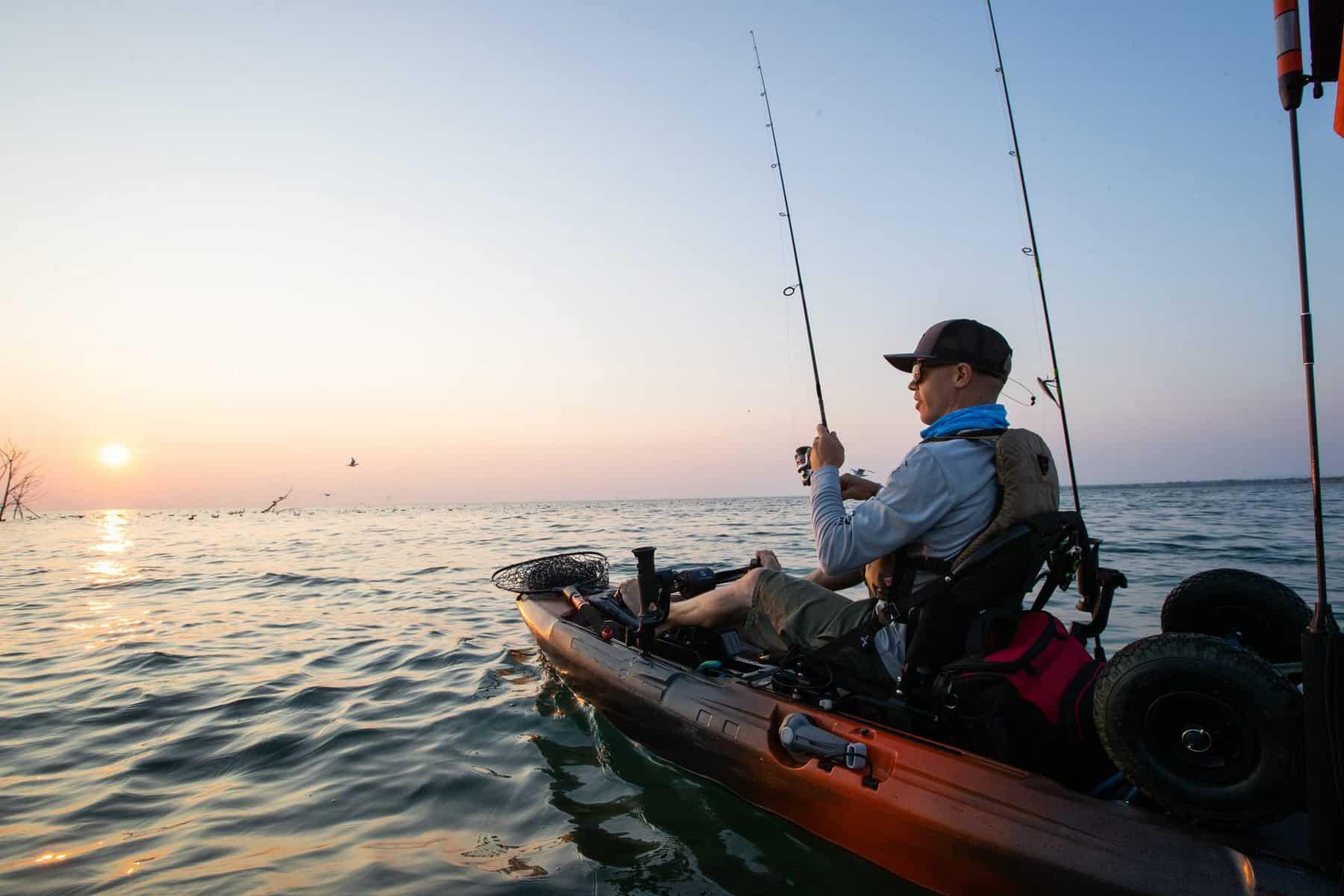 Man in Fishing Kayak on ocean