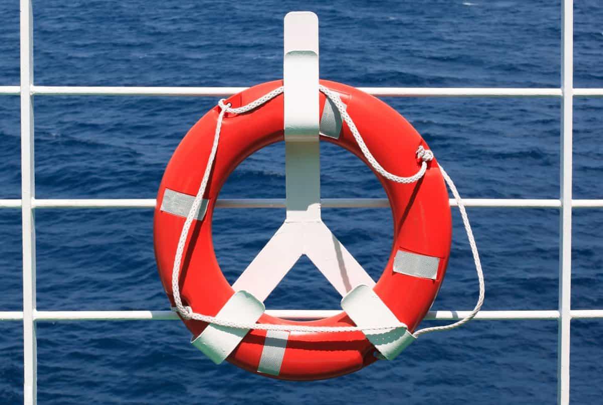 Life buoy on rail sea background