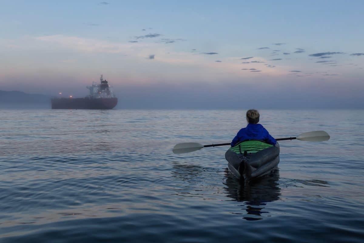 Lone girl is kayaking on an inflatable kayak