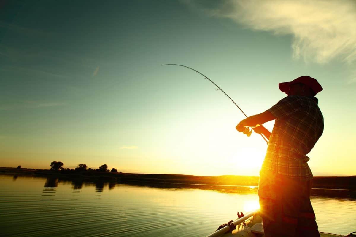 Man Fishing from a Kayak at sunset