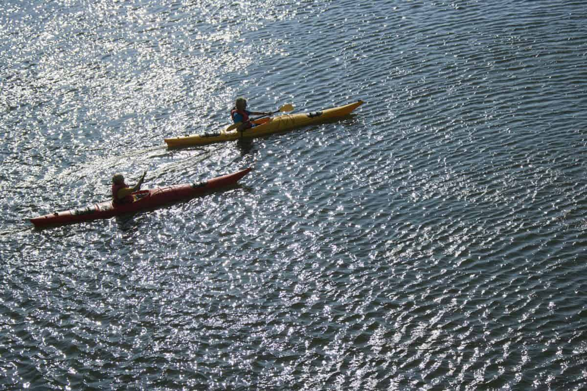 Boys sea kayaking