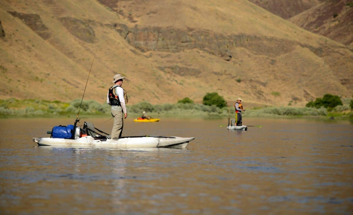 Two men fishing out of inflatable kayaks in Oregon