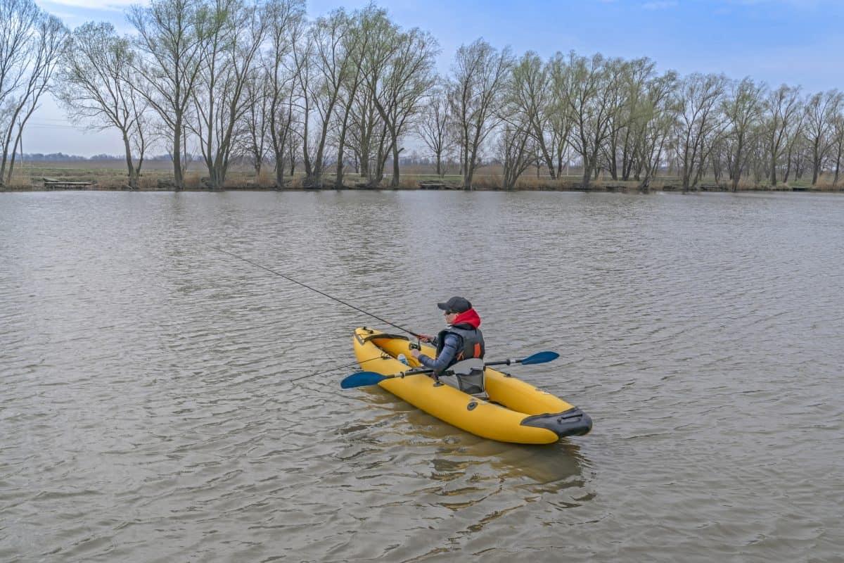 Man in inflatable fishing kayak